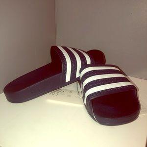 adidas Originals Adilette sliders in navy